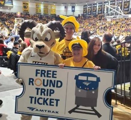 April Sullivan with her children, Matthew and Katie, at the VCU-Richmond game in February. They won two free round-trip train tickets and a hotel room for the A-10 tournament in Brooklyn. (Photo courtesy of April Sullivan)