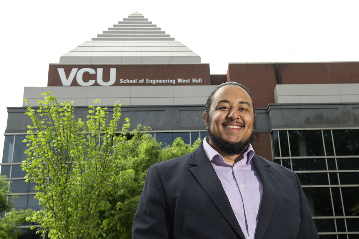 VCU student Myles Boyd standing in front of Engineering West Hall.