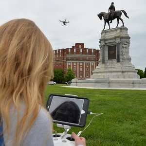 VCU alumna Ashley McCuistion pilots a drone to take photographs of the Robert E. Lee monument on Richmond's Monument Avenue.
