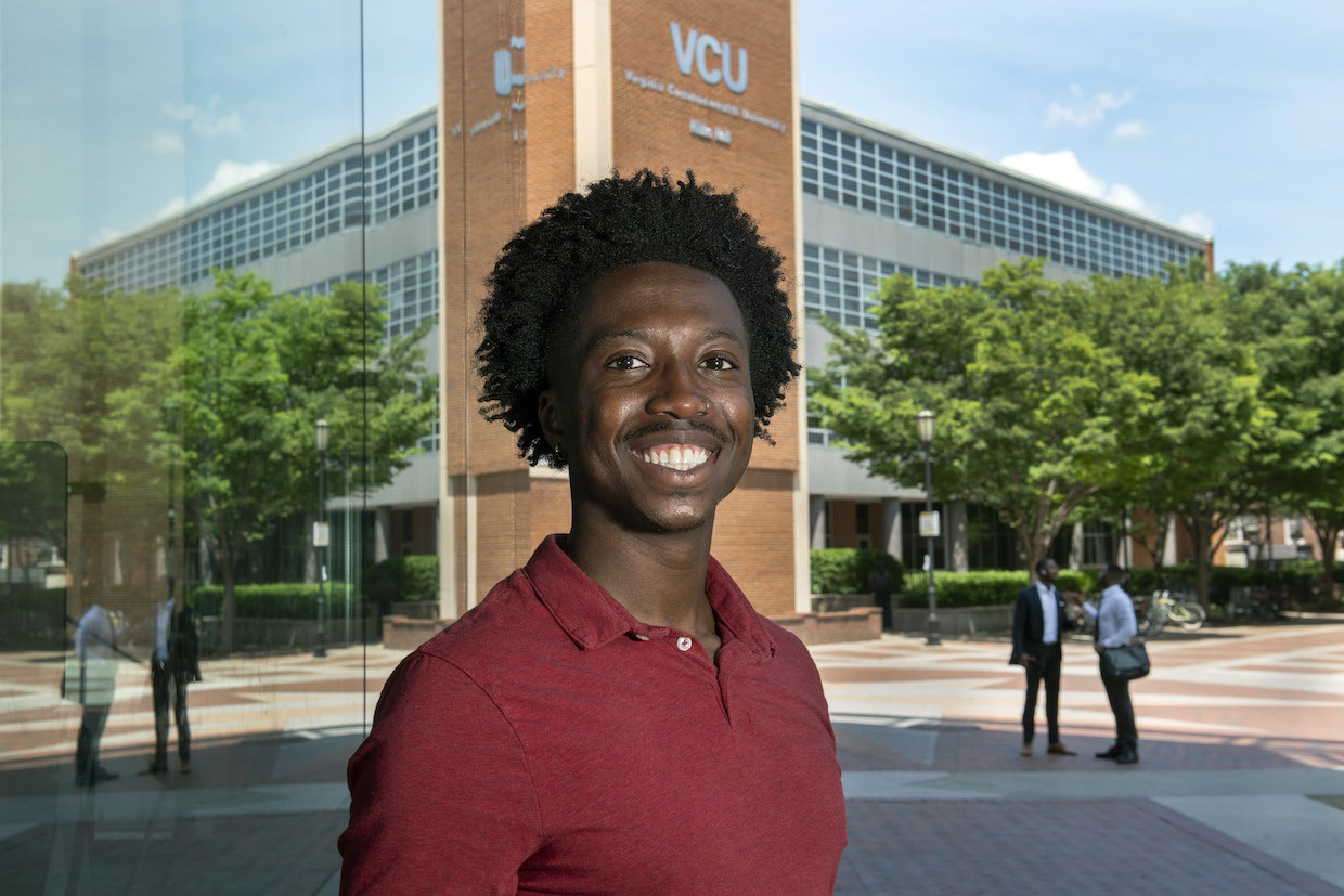 VCU student Gideon Boakye standing in front of Hibbs Hall on the Monroe Park Campus.
