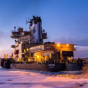 Ship breaking ice in arctic waters.