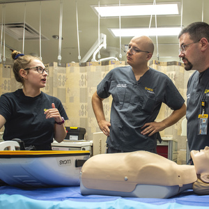 Kaylee Eckert and Amir Louka, M.D., emergency medicine physician, walk through the trauma bay at VCU Medical Center.